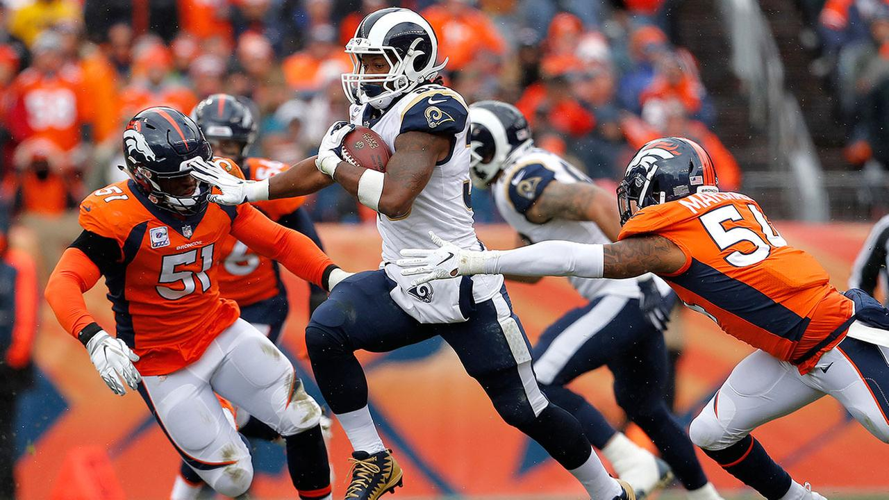 Rams running back Todd Gurley carries the ball as hes chased by two Bronco linebackers during a game in Denver on Sunday, Oct. 14, 2018.