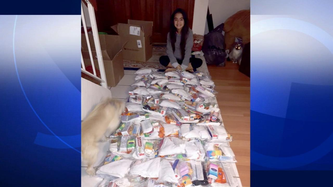 Valerie Fiore sits in front of rows of care packages that will be delivered to homeless people in downtown Los Angeles.
