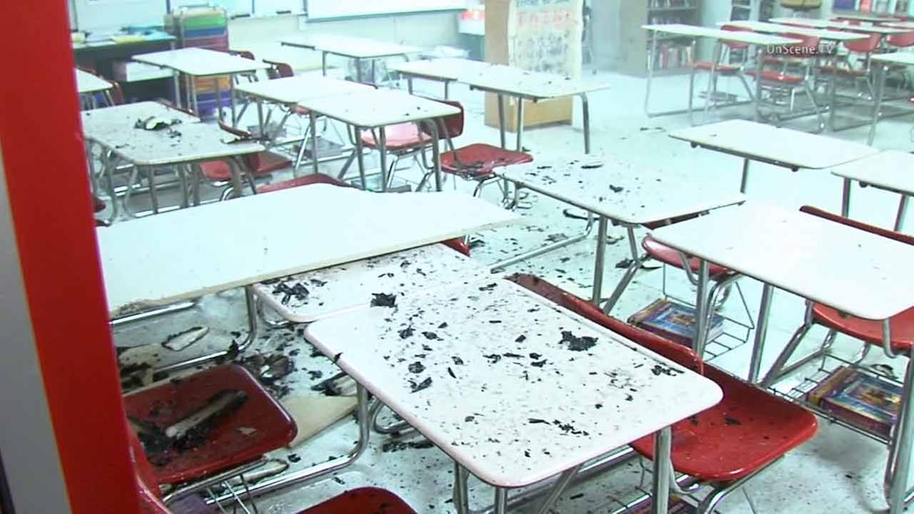 Debris is shown inside a Lawndale High School classroom after multiple trash cans caught fire on Sunday, Dec. 28, 2014.
