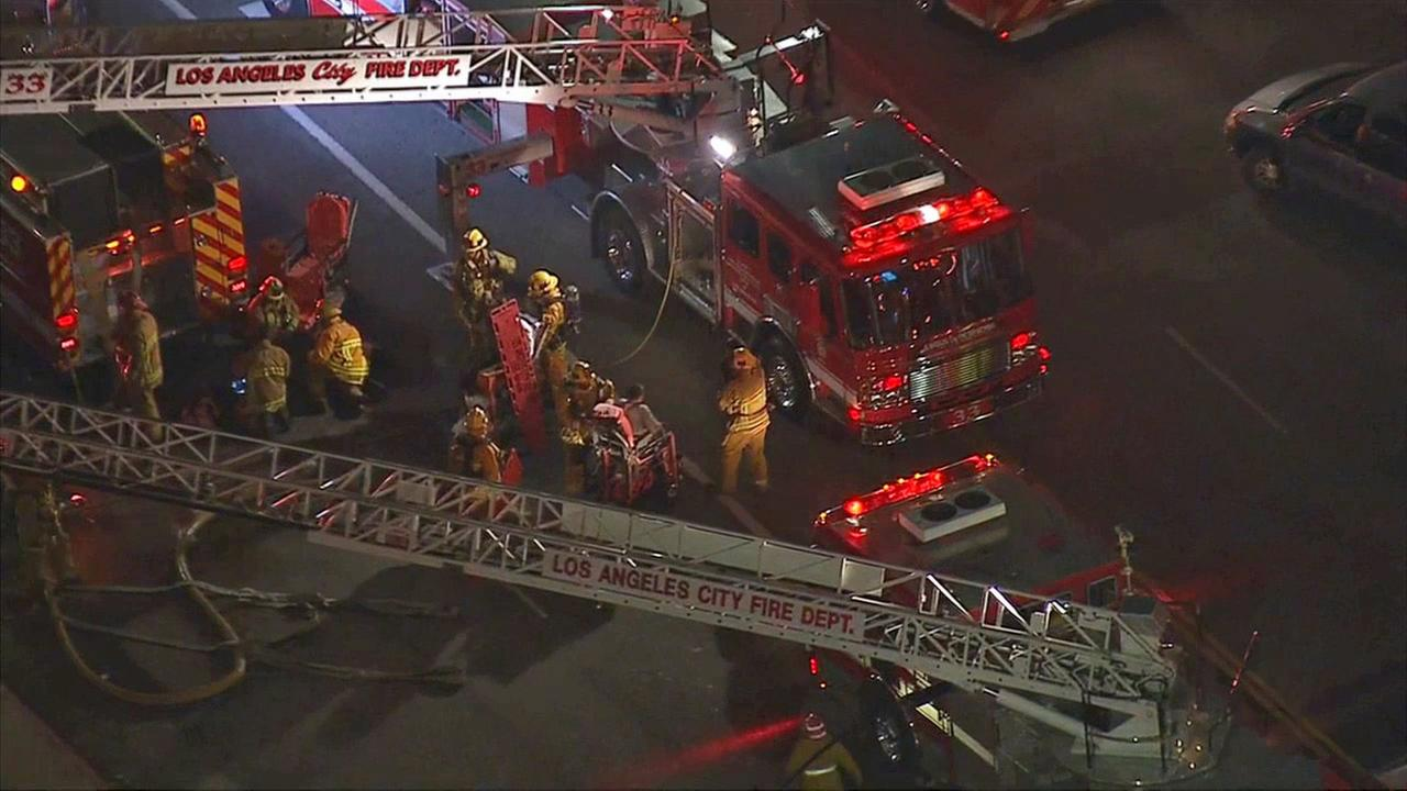 Fire crews respond to a structure fire in South L.A. on Wednesday, Dec. 31, 2014.