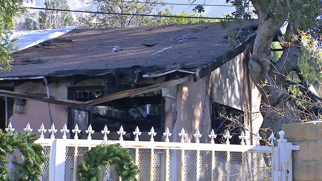 A home in Tujunga is seen after a fire believed to have been caused by a Christmas tree on Saturday, Jan. 3, 2015.