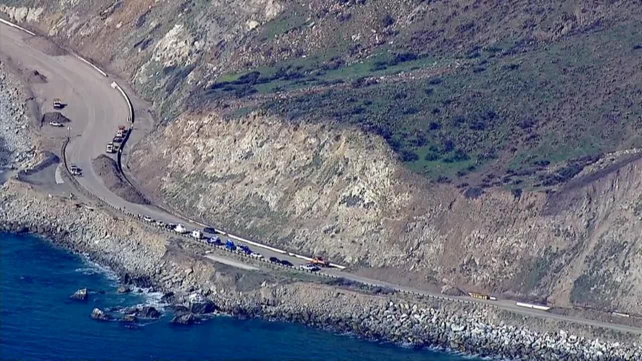 Caltrans climbers helped remove unstable rocks from a hillside along a closed section of PCH on Tuesday, Jan. 6, 2015.