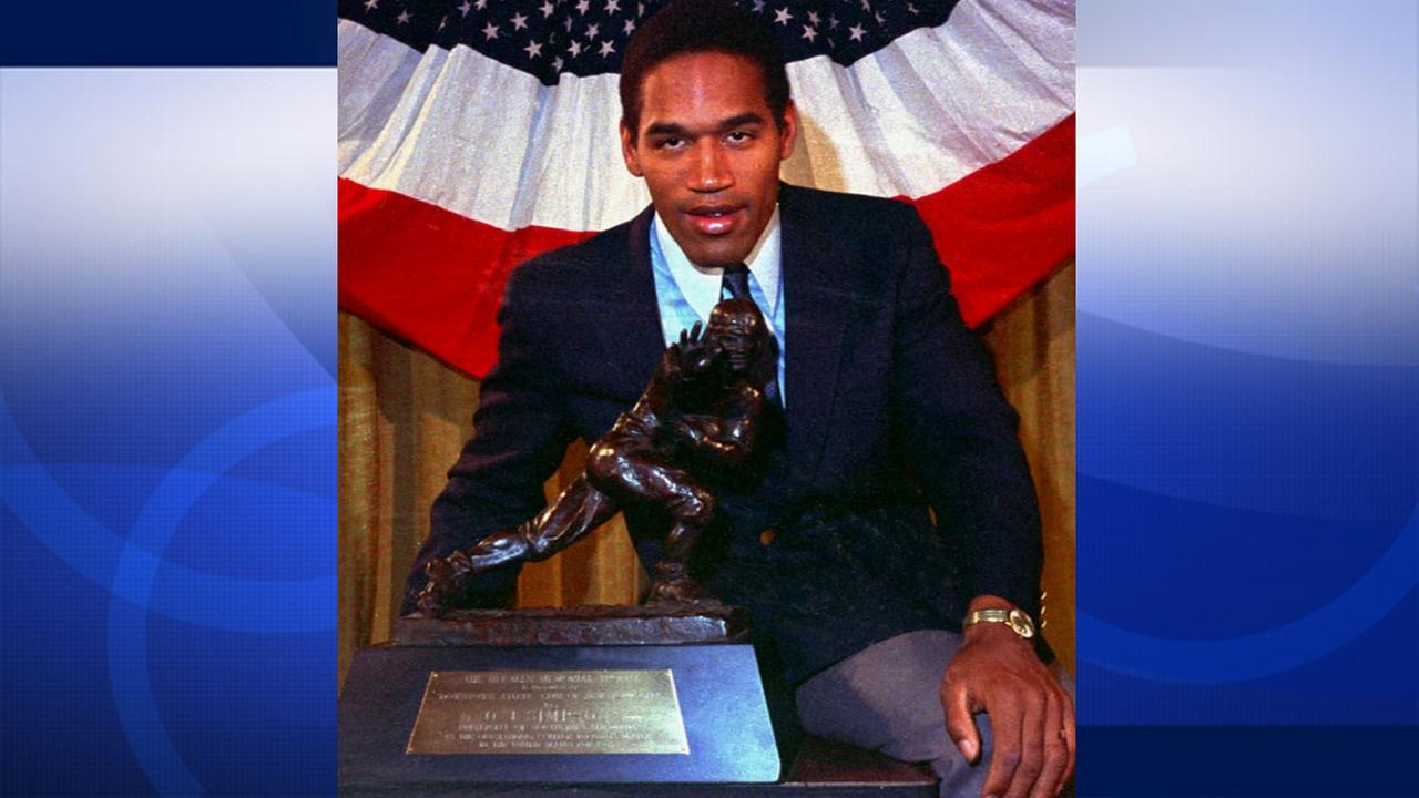 O.J. Simpson is seen with his Heisman Trophy.