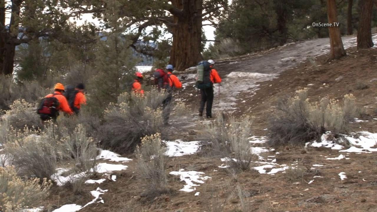 Crews search for Lisa Ann Cimbaluk, a missing woman from Irvine, in the Big Bear area.