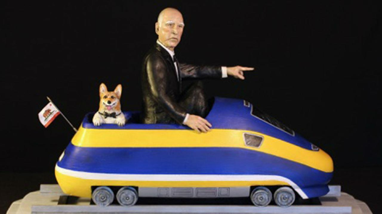 A sculpture depicts California Gov. Jerry Brown and his dog Sutter riding in a high-speed rail cart.