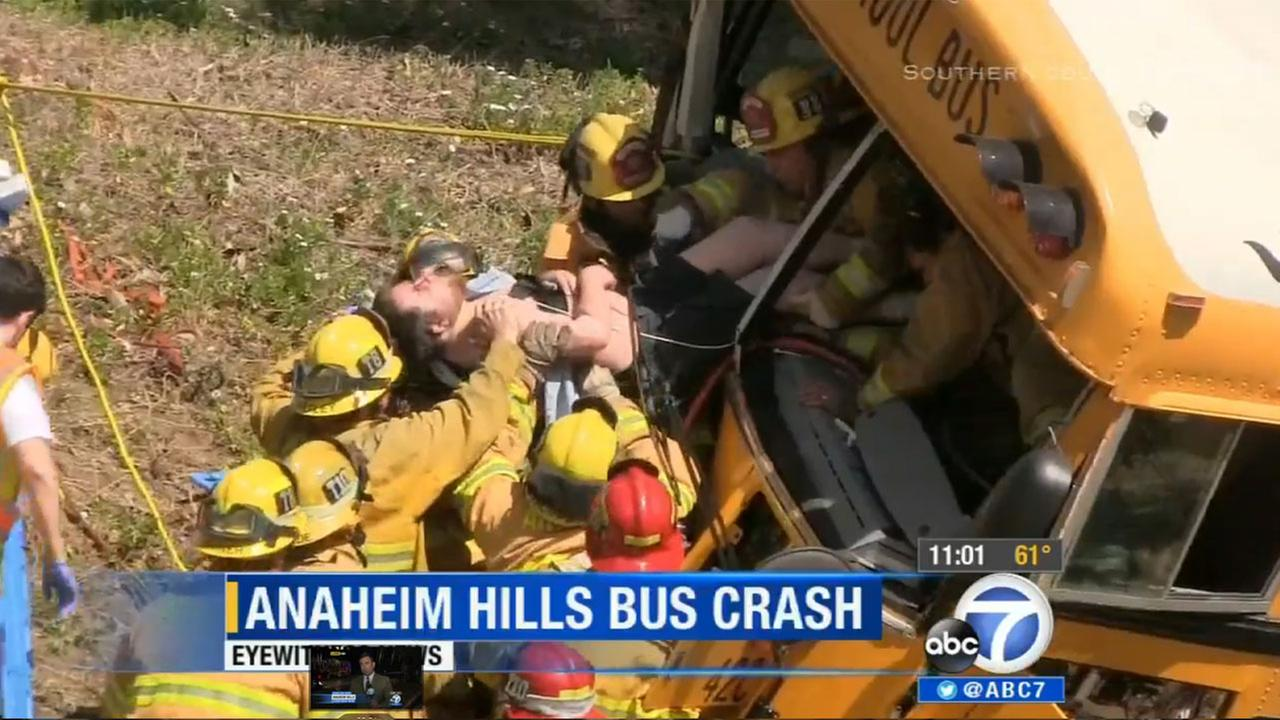 Rescuers pull Gerald Rupple from a mangled school bus in Anaheim Hills. April 24, 2014.
