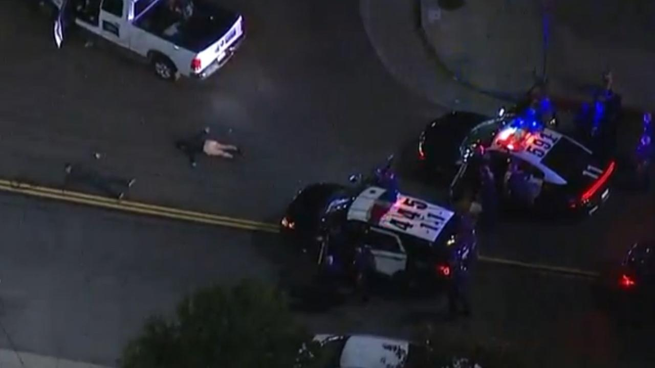 A man and woman surrender to Los Angeles police after leading officers in a pursuit across city streets and the 110 Freeway Friday, Jan. 9, 2015.