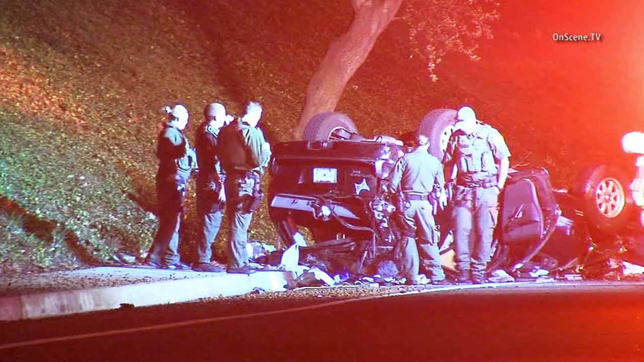 Law enforcement officials investigate the scene of a rollover crash following a chase in Mission Viejo on Friday, Jan. 9, 2015.