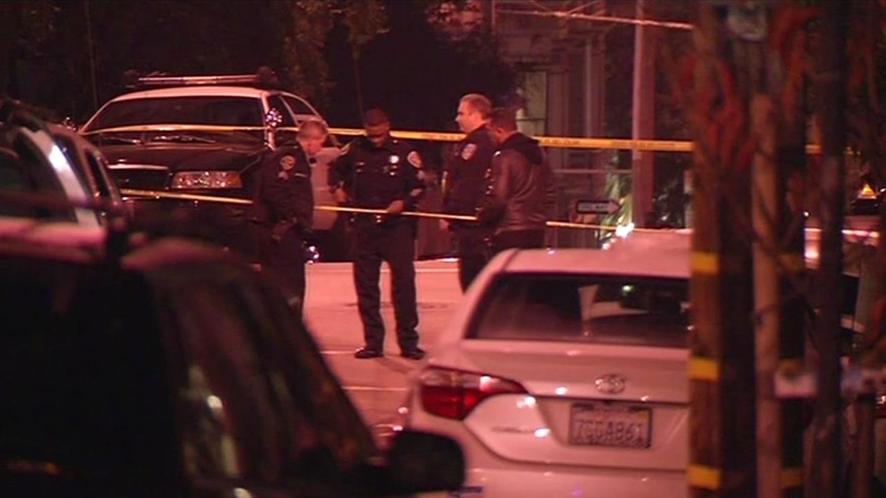 San Francisco police respond to the scene of a fatal shooting in the 200 block of Page Street in the Hayes Valley District Friday, Jan. 9, 2015.