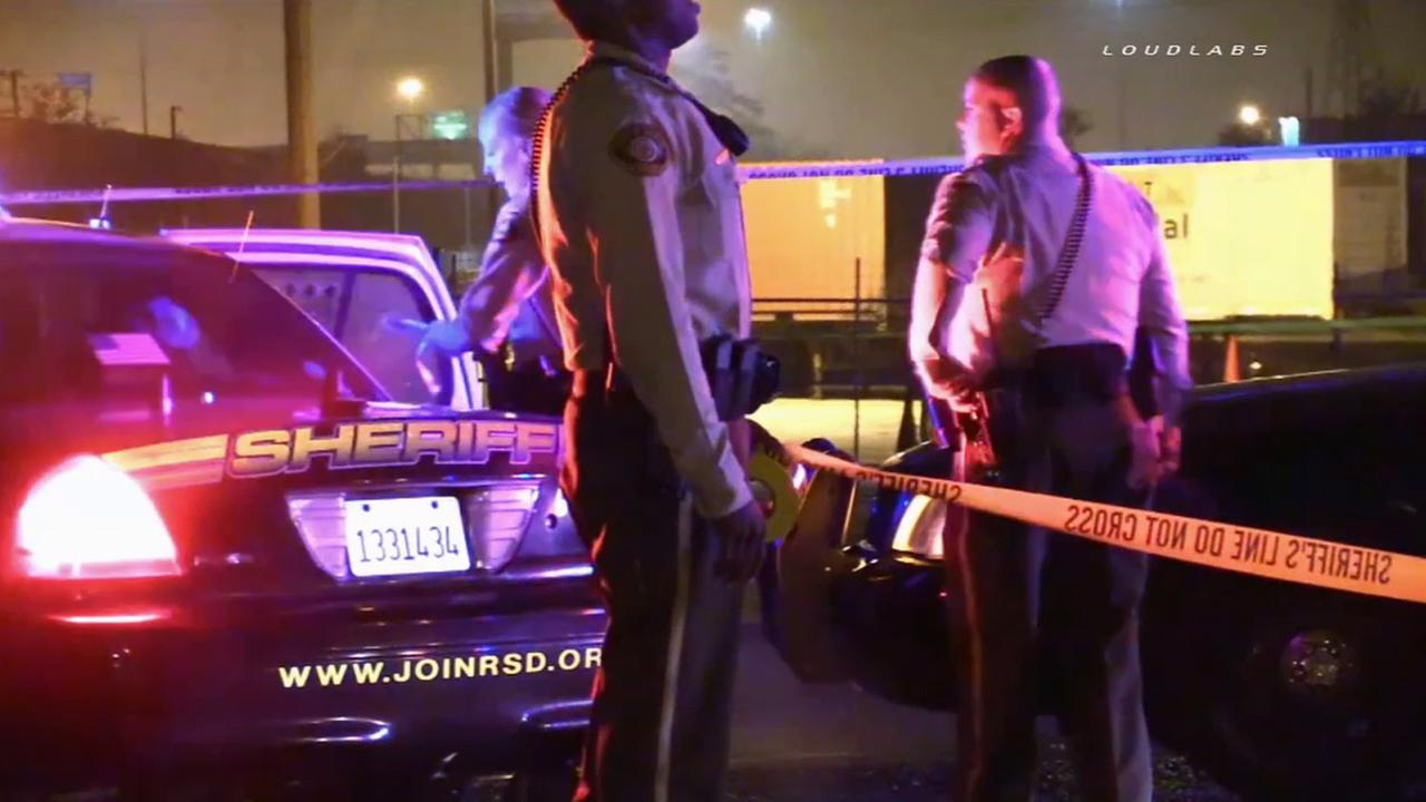 Riverside County sheriffs deputies investigate a robbery that resulted in a person being shot on Sunday, Jan. 11, 2015.
