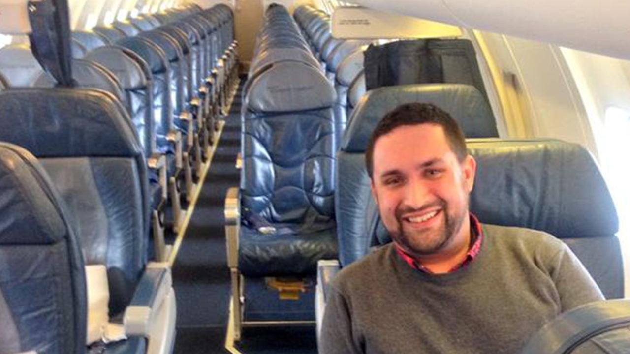 Chris OLeary poses for a photo on an empty Delta Airlines flight on Monday, Jan. 12, 2015.