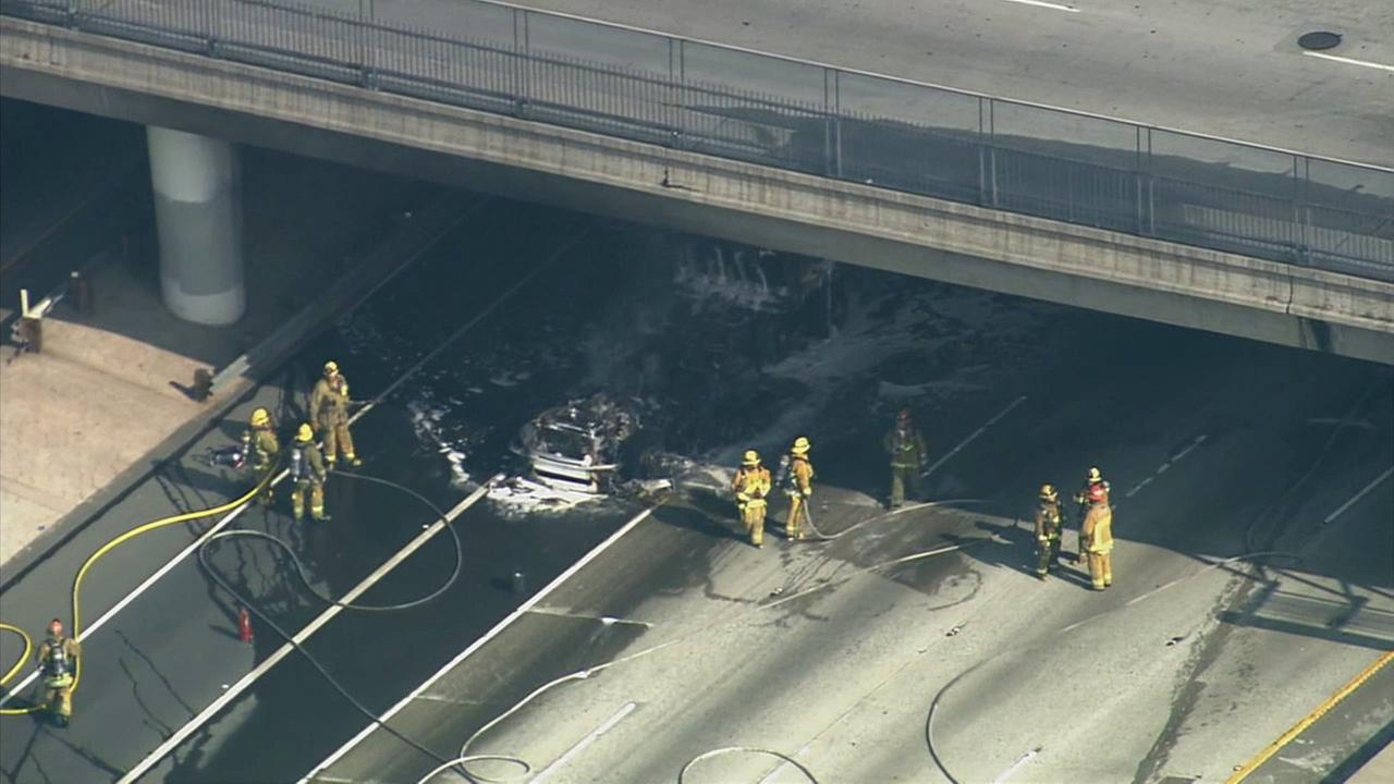 Firefighters respond to a big rig fire on the westbound 10 Freeway in East Los Angeles on Tuesday, Jan. 13, 2015.