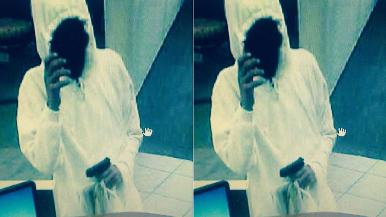 A suspect robs a U.S. Bank branch located on the 19000 block of Van Buren Boulevard in Riverside Tuesday, Jan. 13, 2015.