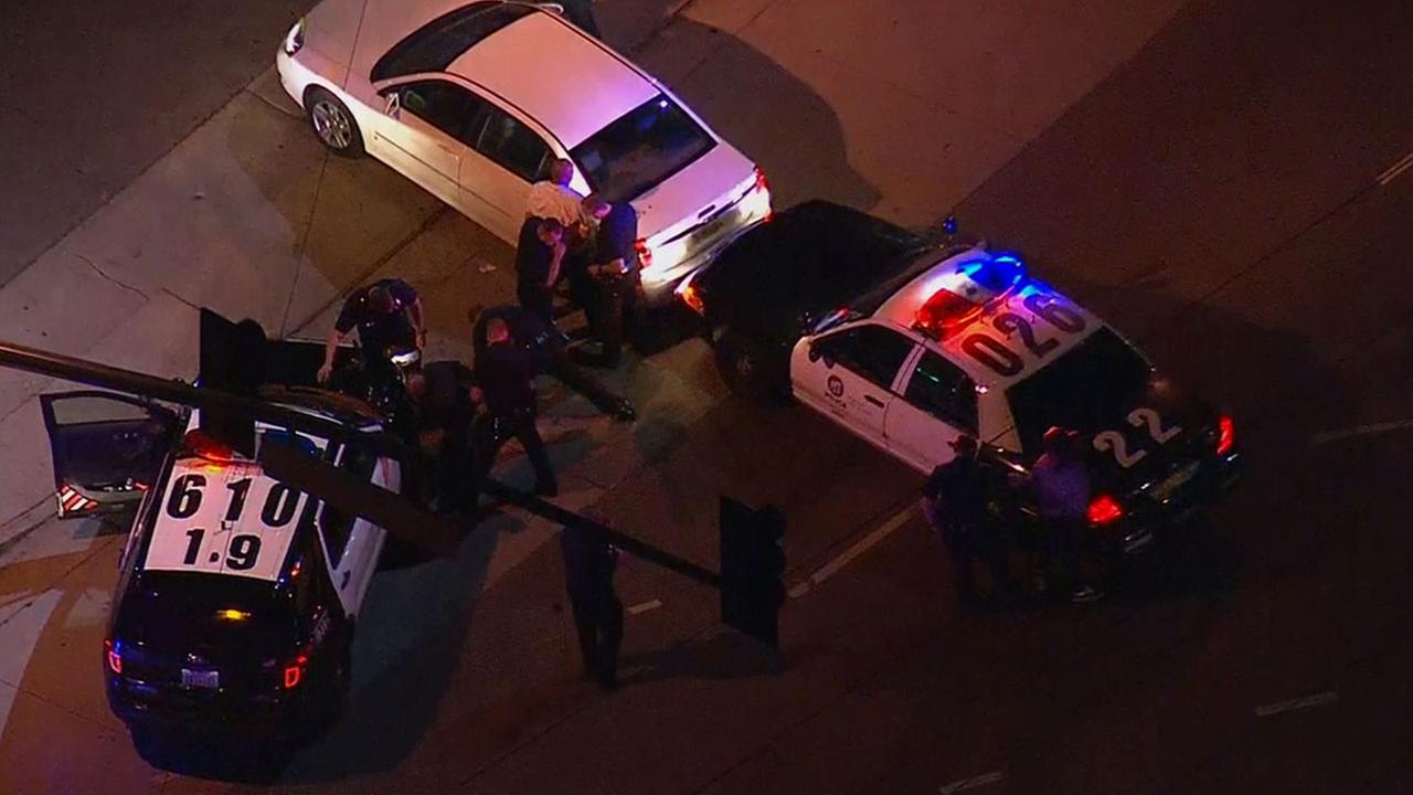 A pursuit ended at the intersection of Vineland Avenue and Chandler Boulevard in North Hollywood Wednesday, Jan. 14, 2015 after LAPD officers performed a PIT maneuver.