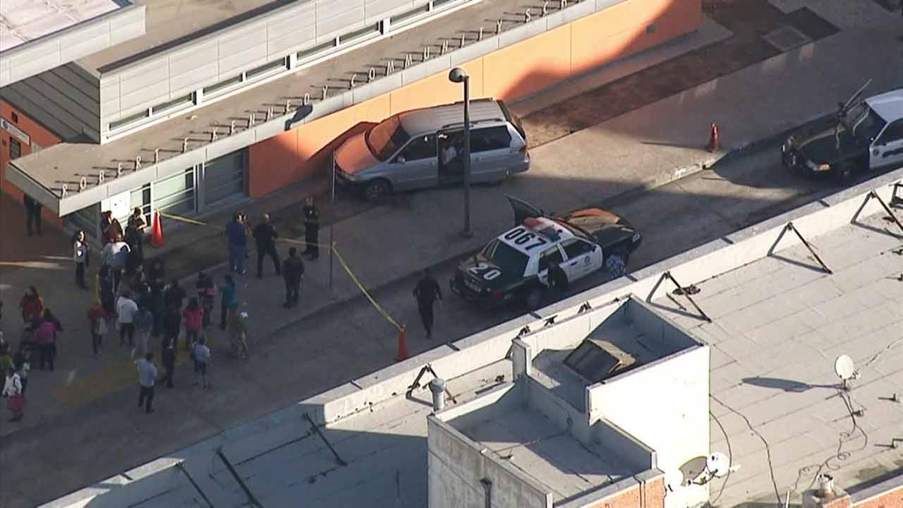 A minivan struck and injured two adult pedestrians and careened into the side of a school in Koreatown on Friday, Jan. 16, 2015.