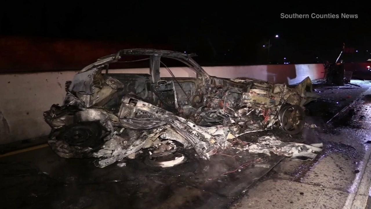 The burnt remains of a Nissan Altima is shown after a fiery crash on the westbound 91 Freeway in Bellflower on Sunday, Jan. 18, 2015.