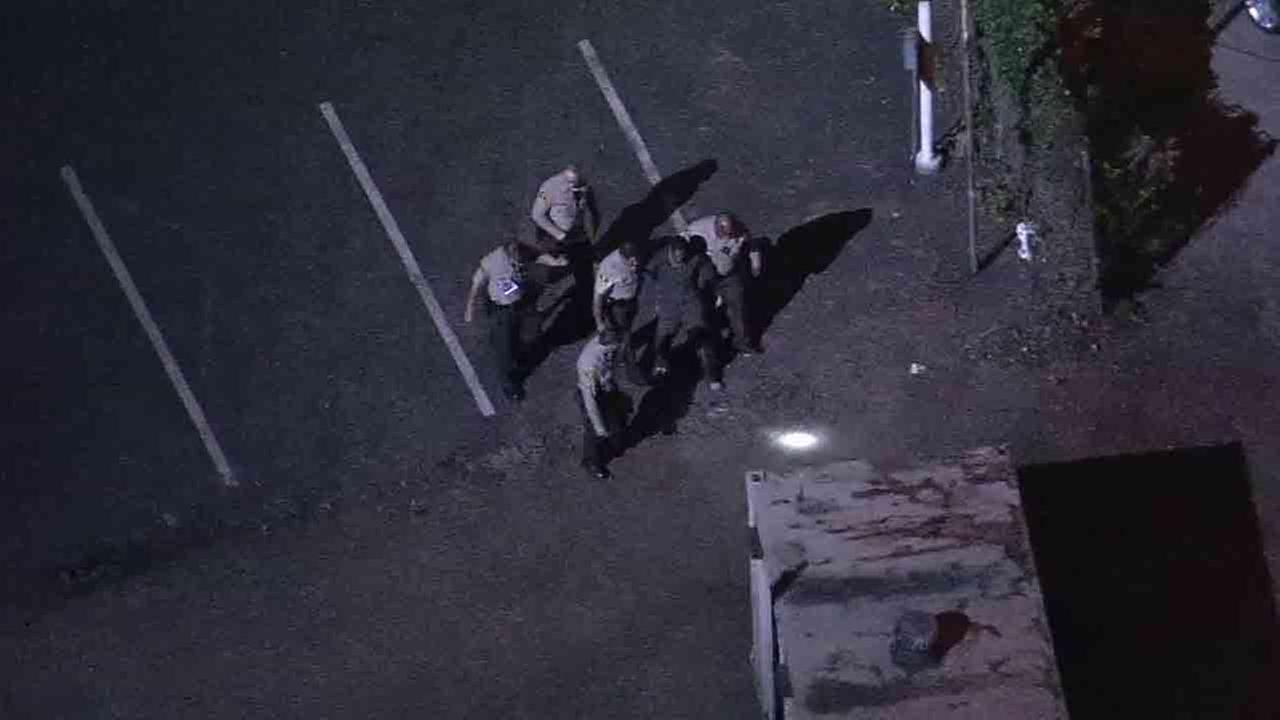 An inmate who escaped from a sheriffs patrol while in handcuffs was found hiding underneath a vehicle in a downtown Los Angeles car lot Friday, Jan. 23, 2015.