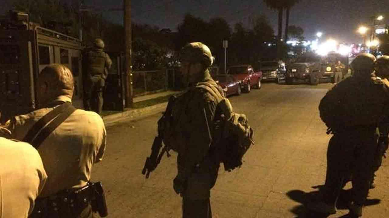 SWAT units search the 1000 block of Ditman Avenue in East Los Angeles for a suspected gunman following a deputy-involved shooting Saturday, Jan. 24, 2015.