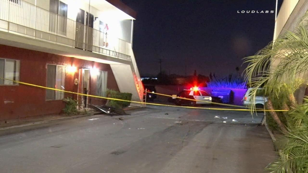 Sheriffs deputies investigate after a car slammed into an apartment building in Pico Rivera on Saturday, Jan. 24, 2015.