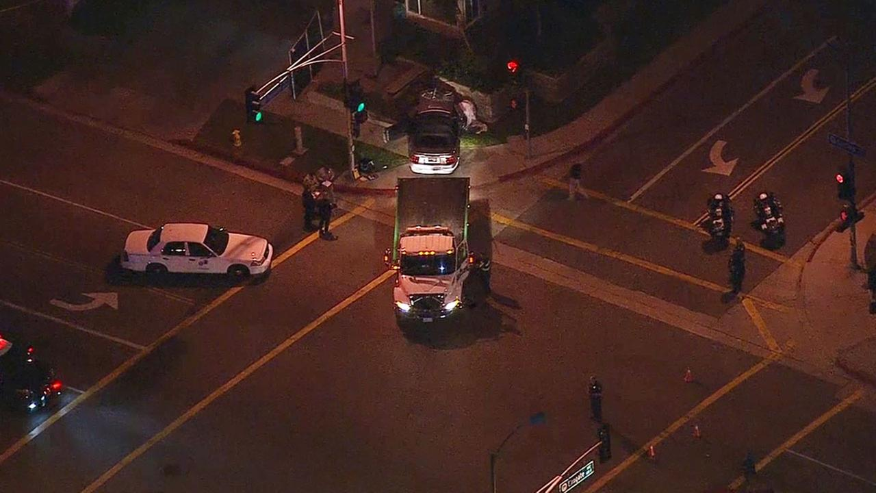 Monterey Park police and California Highway Patrol officers respond to the area near South Garfield Avenue and Elmgate Street where a crossing guard was fatally struck.