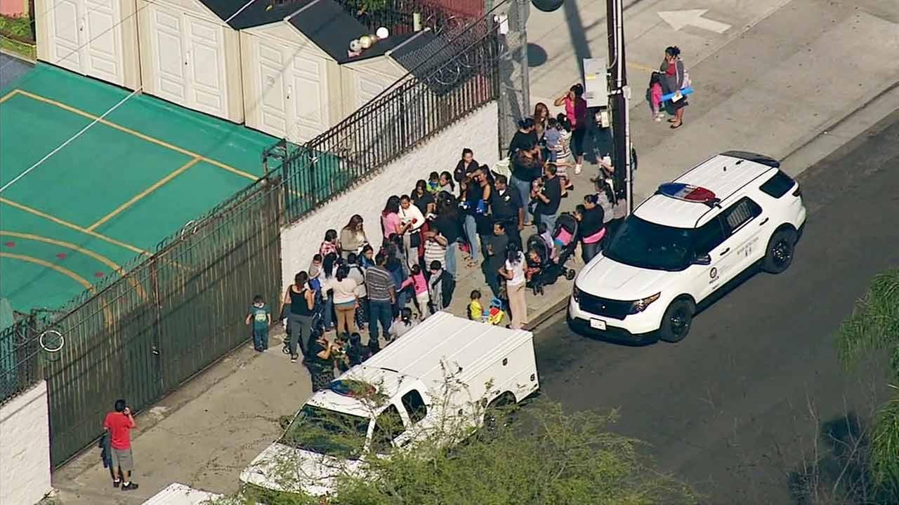 A crowd gathers outside of MacArthur Park Elementary School in the Westlake District after the school was evacuated due to a bomb threat on Tuesday, Feb. 3, 2015.