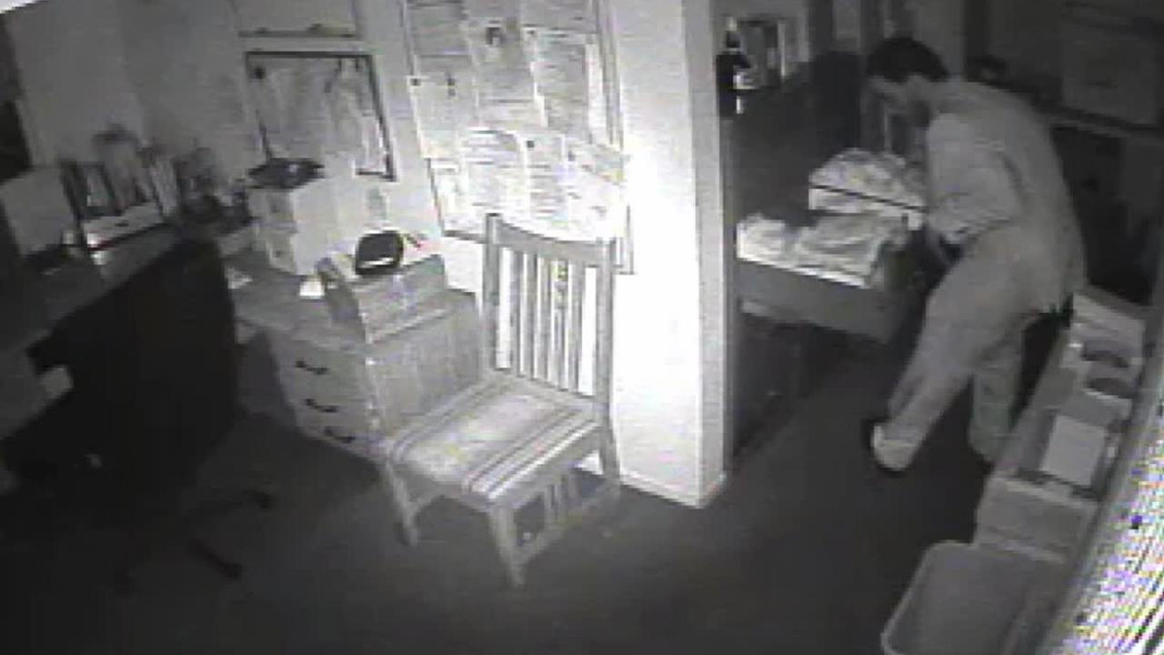 A man dressed in a suit is caught on surveillance video burglarizing a Mexican food restaurant on Saturday, Jan. 31, 2015.