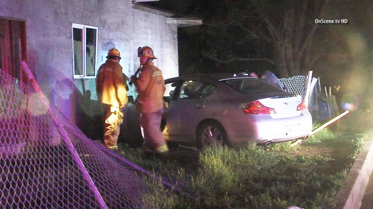 Robbery suspects crashed their vehicle into a vacant home in Glendora on Saturday, Feb. 7, 2015.