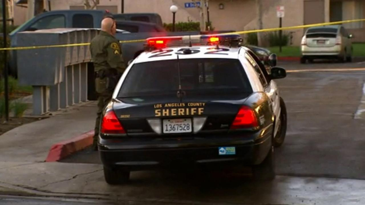 Los Angeles County sheriffs deputies investigate a woman who allegedly shot at two people in Santa Clarita on Sunday, Feb. 8, 2015.