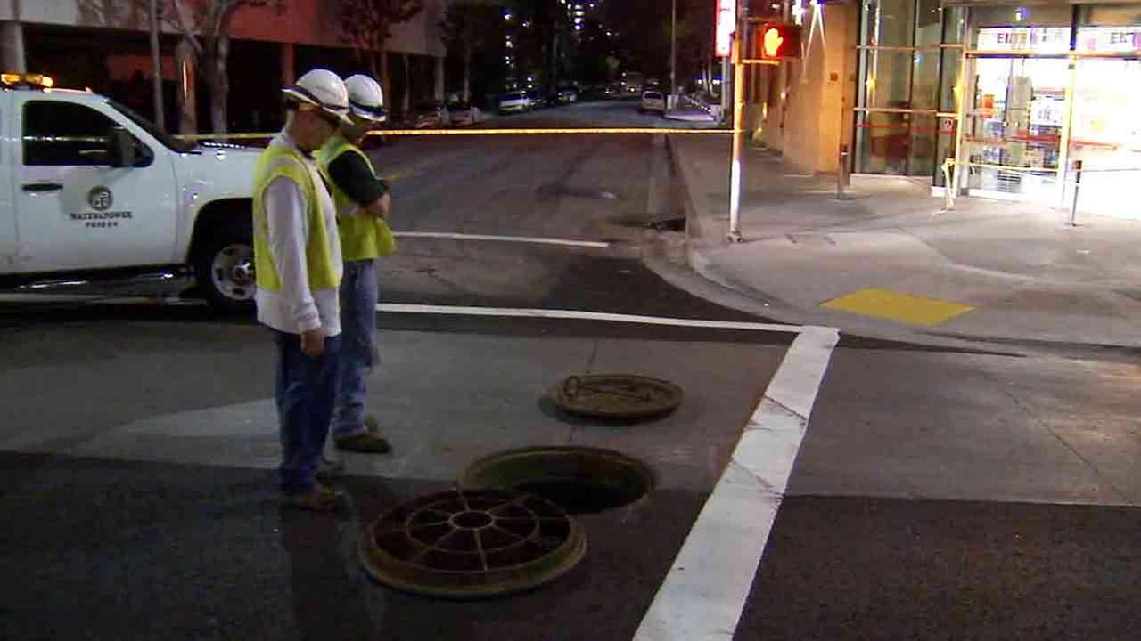 A small underground explosion closed Wilshire Boulevard between Curson Avenue and Hauser Boulevard in Los Angeles Sunday, Feb. 8, 2015.