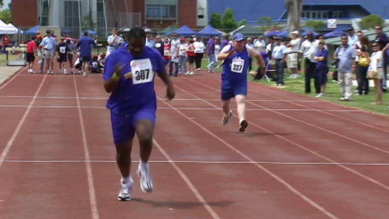 Two Special Olympics athletes compete in a sprint event in this undated photo.