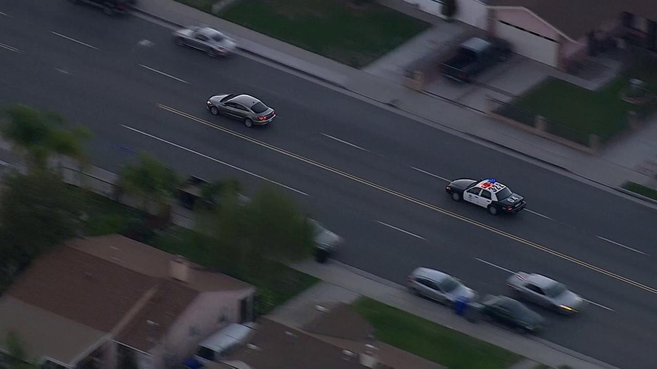 LAPD chase a suspect who had just carjacked the vehicle from a woman in a residential area on Monday, Feb. 9, 2015.