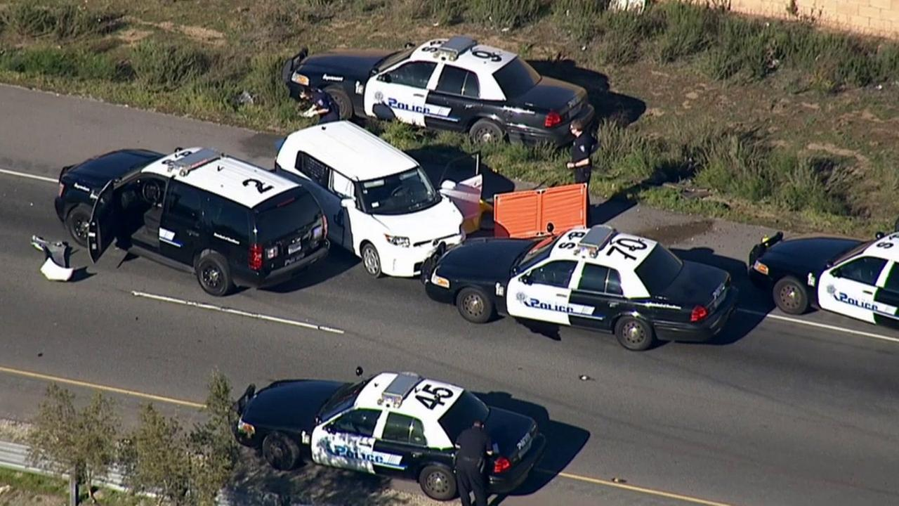 San Bernardino police investigate a fatal officer-involved shooting on the northbound 215 Freeway on Friday, Feb. 13, 2015.