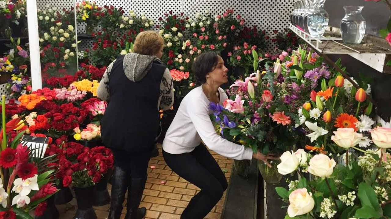 Customers pick out flowers at Toluca Lake Flowers on Saturday, Feb. 14, 2015.