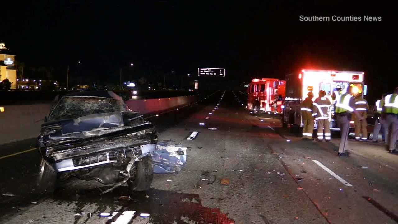 A car involved in a multiple vehicle wreck is shown on the 55 Freeway in Santa Ana on Friday, Feb. 13, 2015.