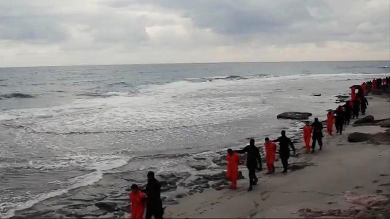 ISIS militants purportedly videotaped Egyptian Coptic Christians in orange jumpsuits being led along a beach, each accompanied by a masked militant on Sunday Feb. 15, 2015.