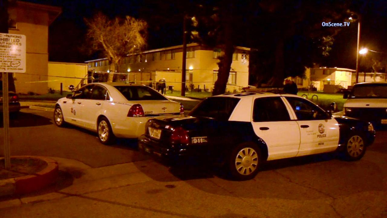 Los Angeles police respond to a shooting that killed a 50-year-old man and injured another on Saturday, Feb. 14, 2015.