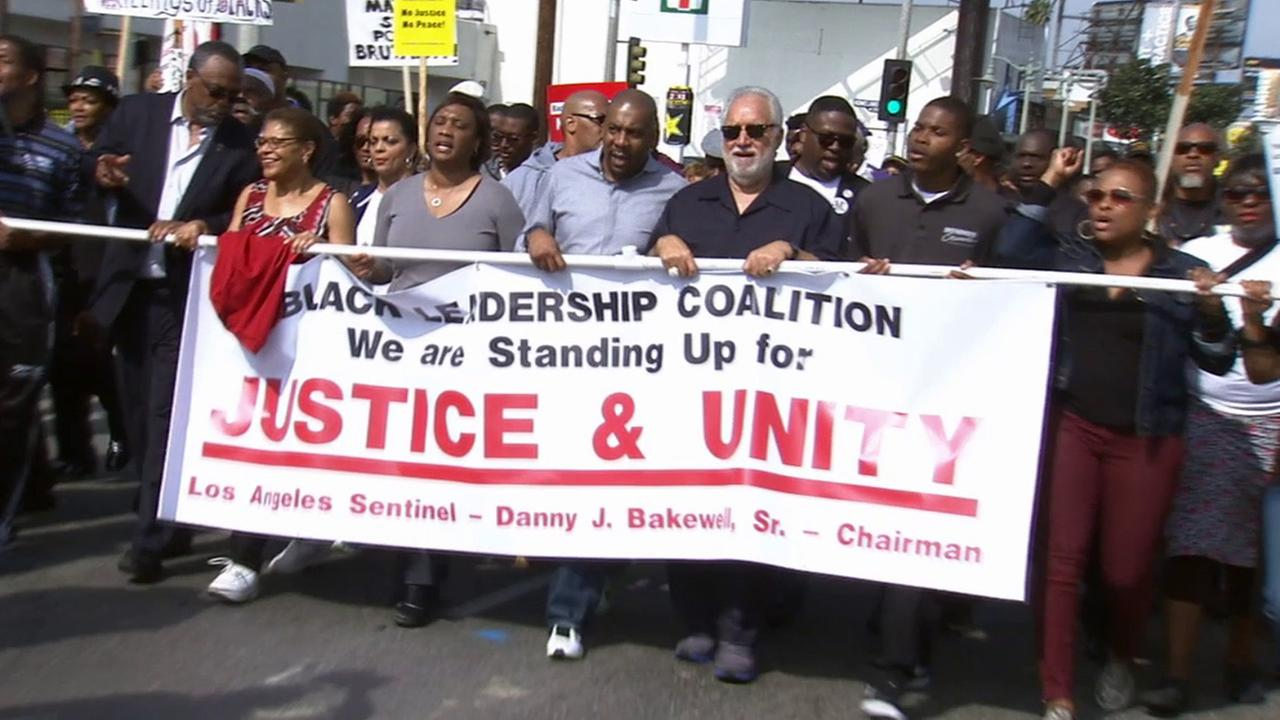 Community activists, clergy and politicians marched against police violence and brutality in South Los Angeles on Saturday, Feb. 21, 2015.