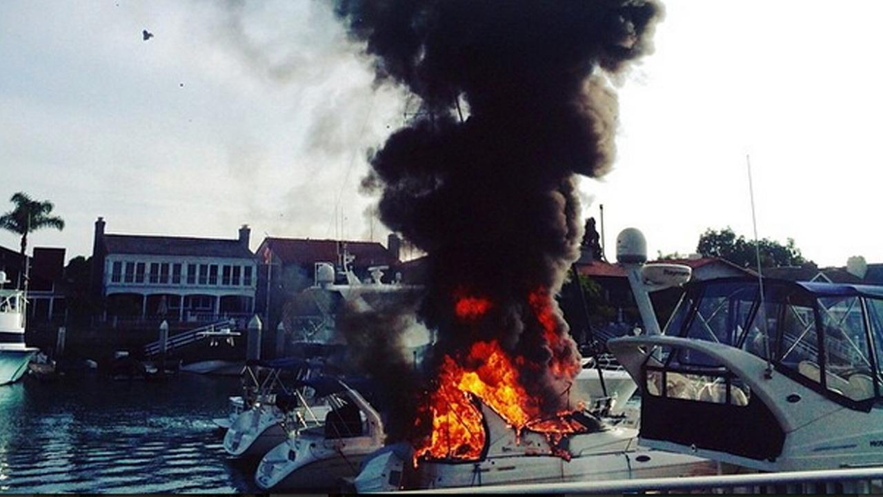 Smoke and flames rise from a 30-foot boat on fire in Newport Beach on Saturday, Feb. 21, 2015.