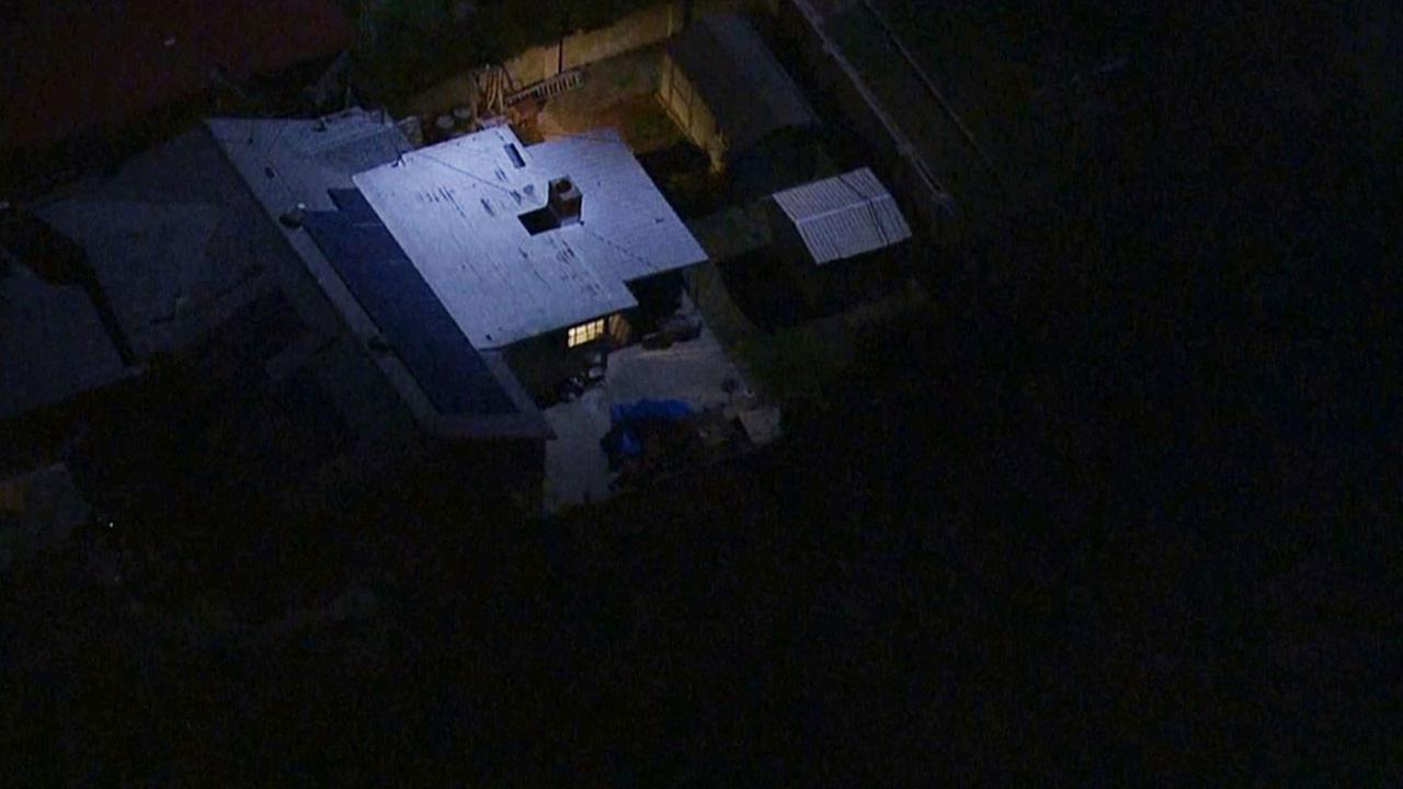 Los Angeles police officers set up a perimeter near Woodale Avenue and Wentworth Street in Pacoima in search of two suspects Wednesday, Feb. 25, 2015.