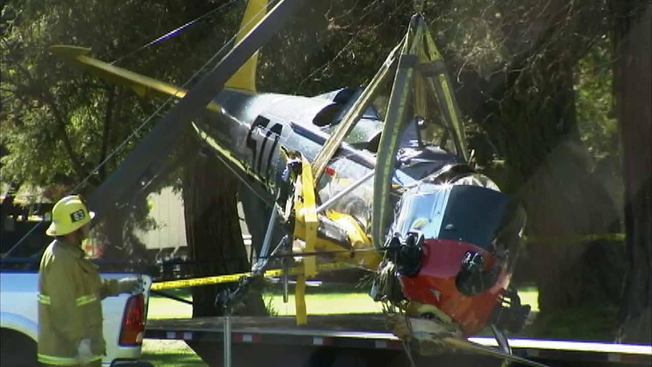 Crews remove the plane crashed by actor Harrison Ford from a golf course in Venice on Friday, March 6, 2015.