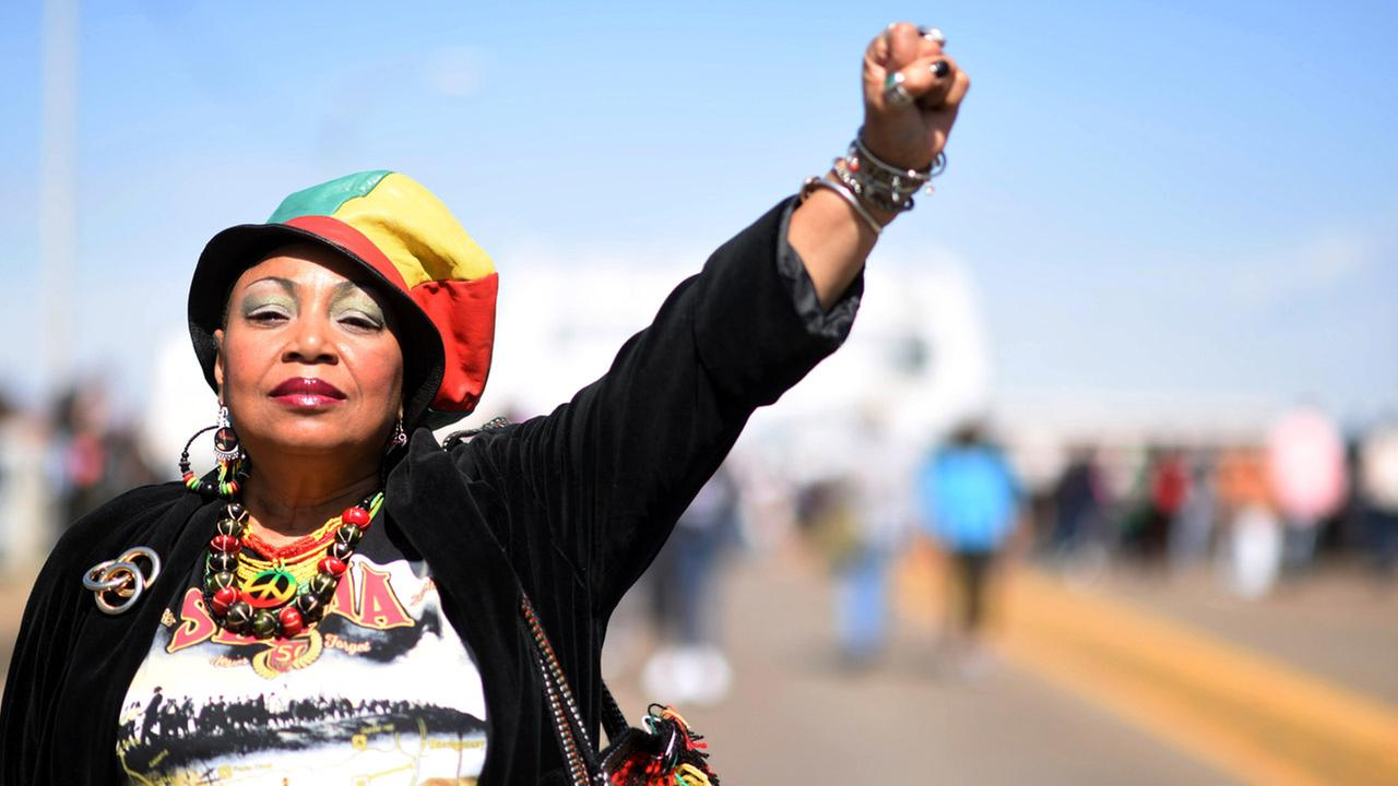 Mercedes Binns, who has been to Selma 17 times because of its civil rights history, walks on the Edmund Pettus Bridge, Sunday, March 8, 2015, in Selma, Ala.