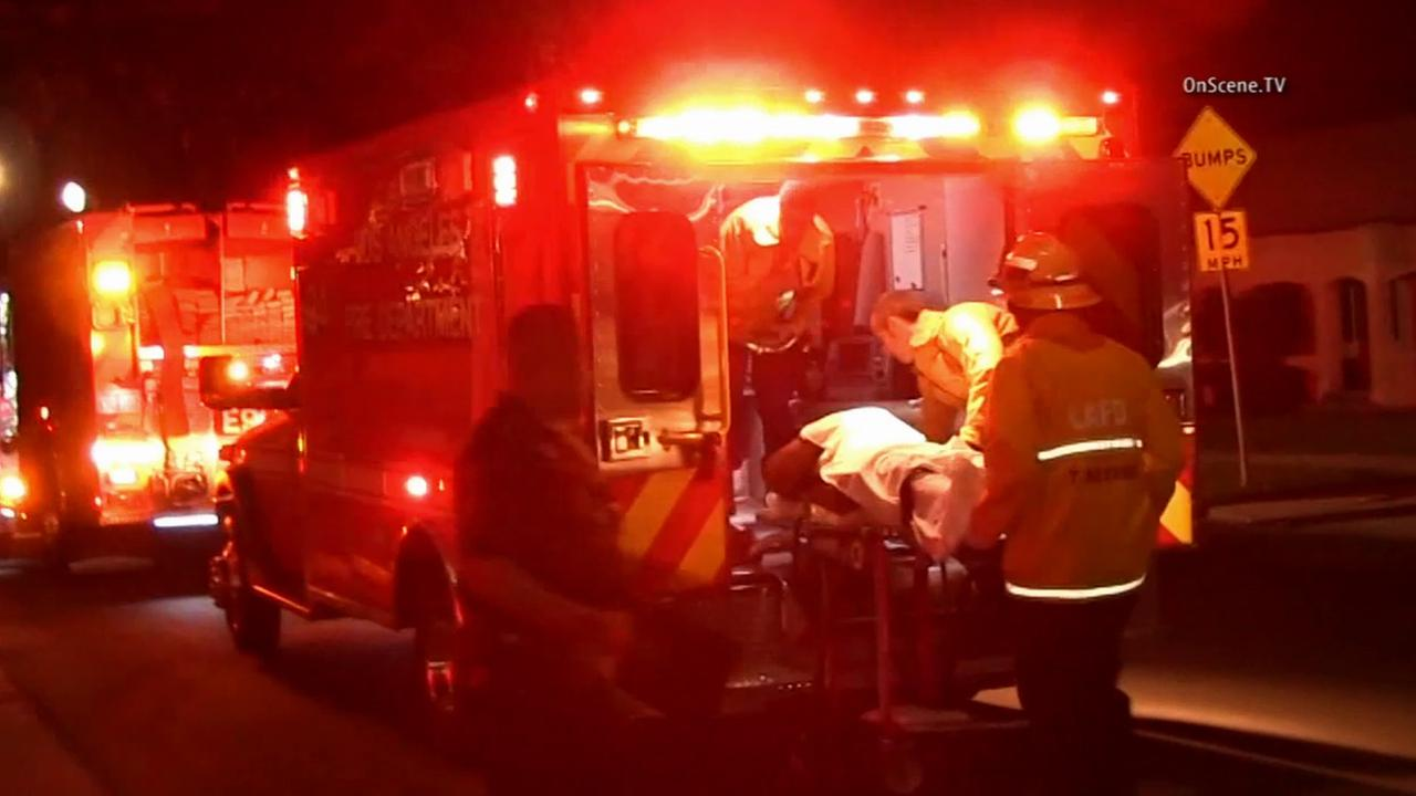 Firefighters move a security guard shot in an attempted robbery into an ambulance in Hyde Park on Sunday, March 8, 2015.