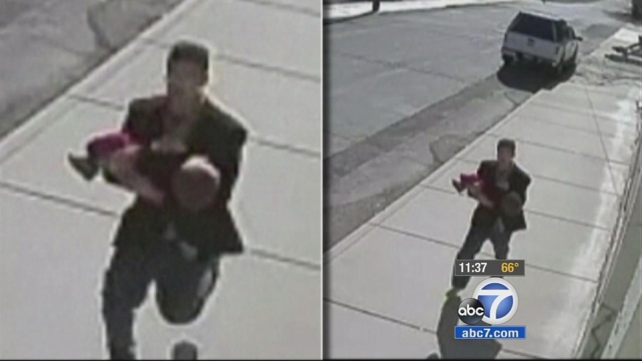 Surveillance images show a man trying to kidnap a 22-month-old child from a park in eastern Washington.