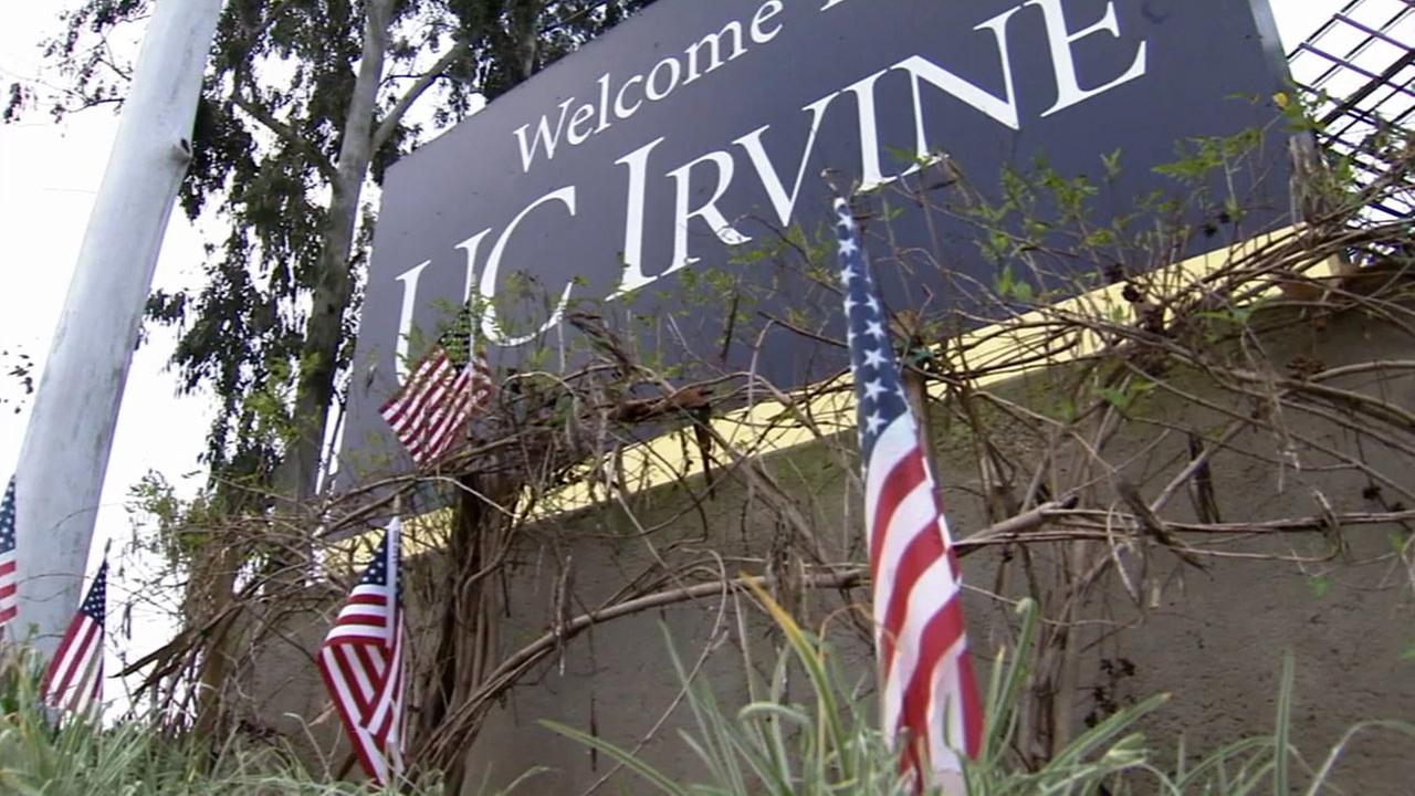 Flags wave in front of a sign for UC Irvine in this undated file photo.