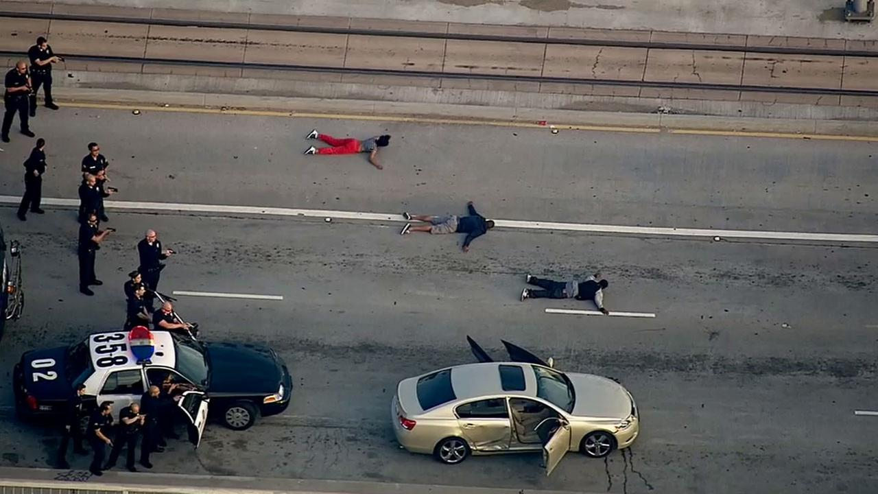 Three alleged shooting suspects were taken into custody near Flower Street and Adams Boulevard in downtown Los Angeles after leading police on a pursuit Tuesday, March 10, 2015.