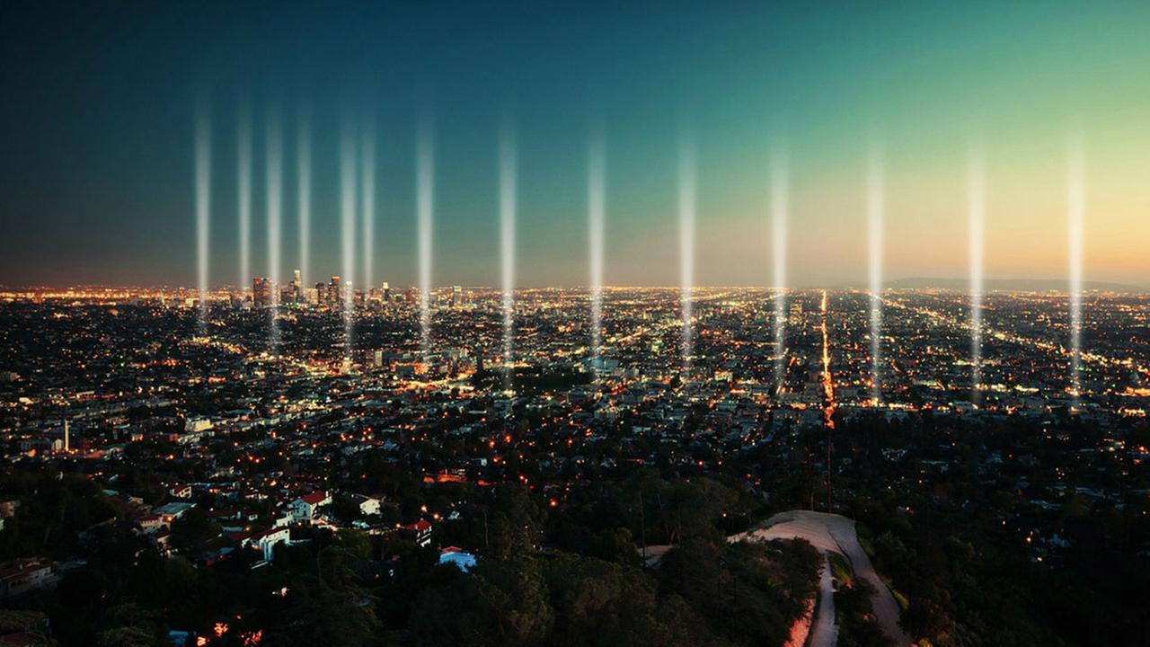 Pillars of light mark each mile along the LA Marathon course in this illustration.