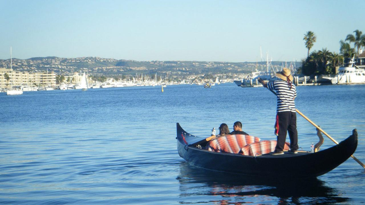 Taking a gondola ride with your special someone through the beautiful bay and canals of Newport Beach makes for a great date idea.