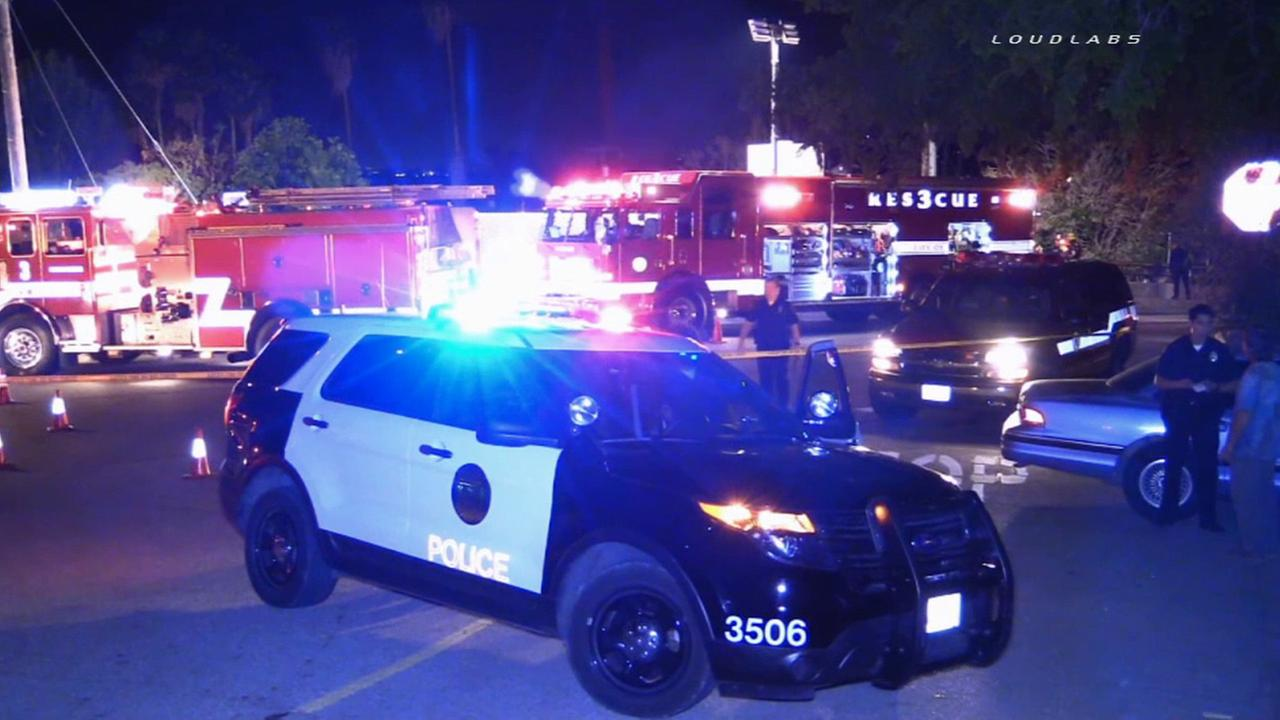Riverside police and firefighters respond to the stabbing of a homeless man near railroad tracks on Friday, March 13, 2015.