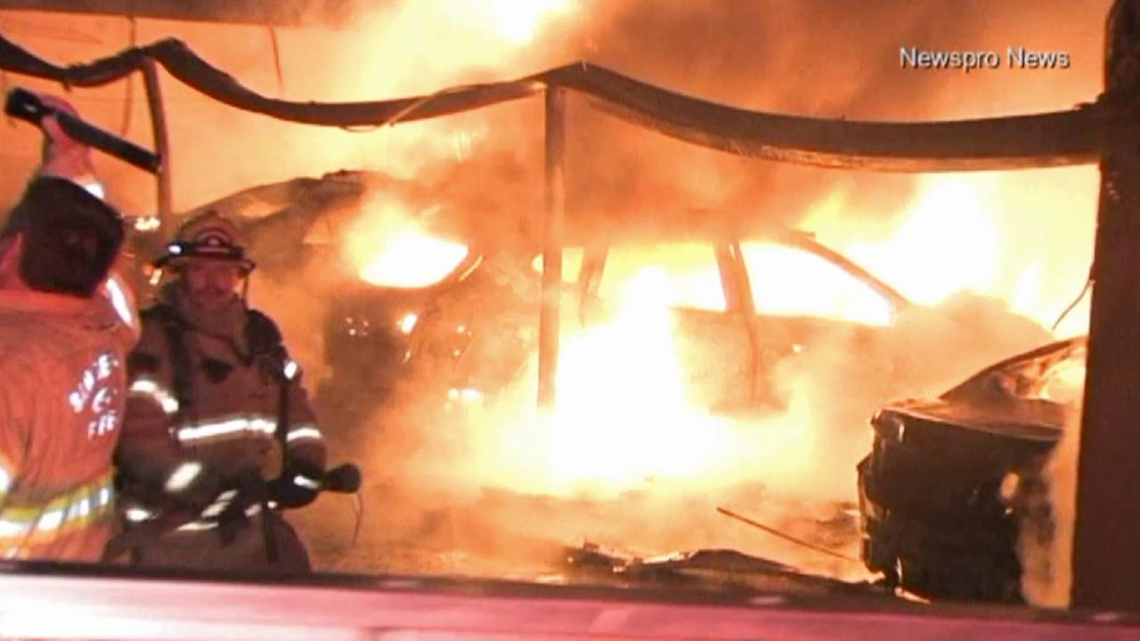 Firefighters battle a fire that broke out at an apartment complex carport in San Bernardino on Saturday, March 14, 2015.