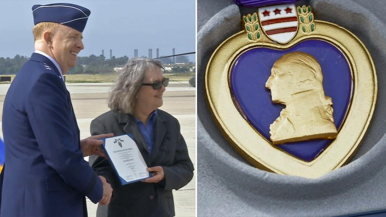 Lorraine Manatt accepts a Purple Heart for her father, who was wounded in World War II and held in a prison camp, Wednesday, March 18, 2015.